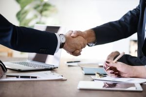 Closeup of a handshake between two businessmen