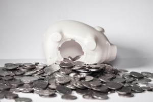 Piggy bank on side with coins